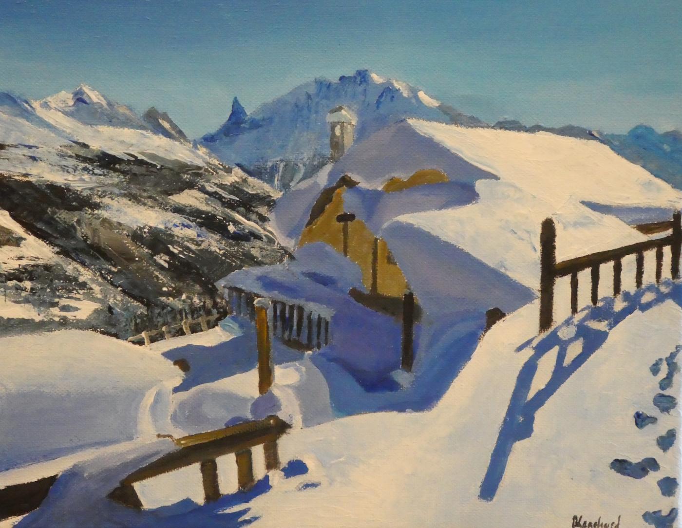 Chalet sous la neige et barrière